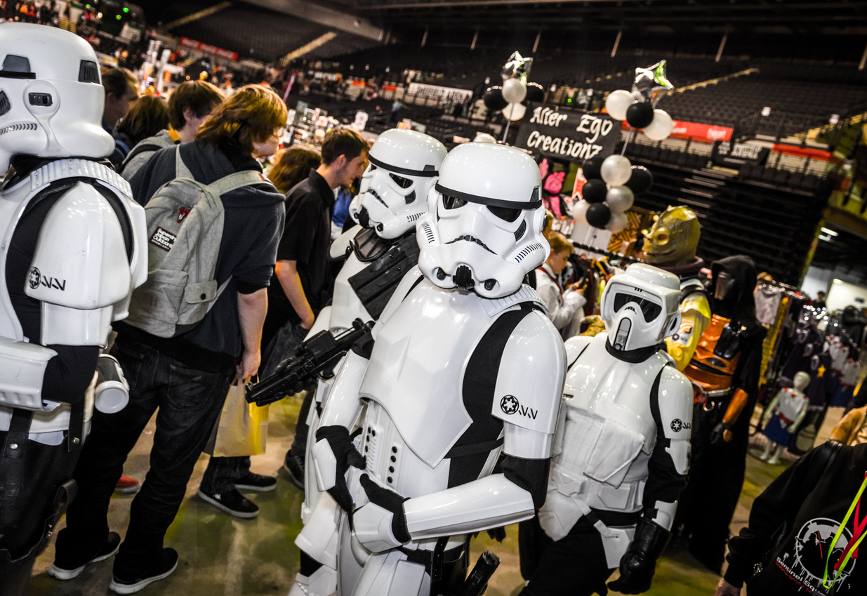 Cosplayers dressed as stormtroopers and biker scout from Star Wars