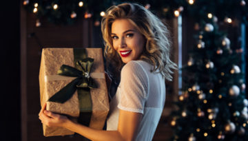 Beautiful woman with present