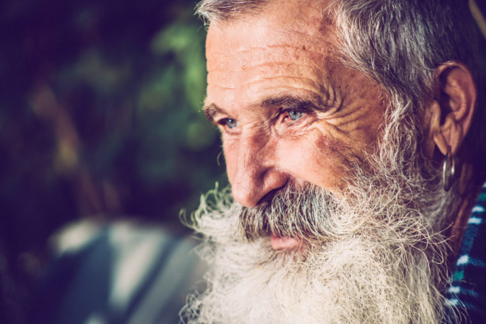 Old Happy Man with Extremely Long Beard Outdoors, Close-up