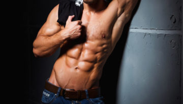 Muscular and sexy torso of young man having perfect abs
