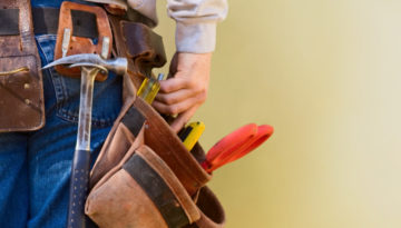 Young Construction Worker Reaches Into His Tool Belt Copy Space