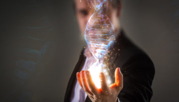 Businessman using his inner powers and holding glowing virtual DNA helix with energy sparks - business, creation, genetics, future and science concept